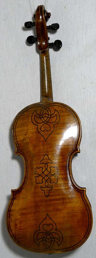 decorated violins. Black Bedroom Furniture Sets. Home Design Ideas